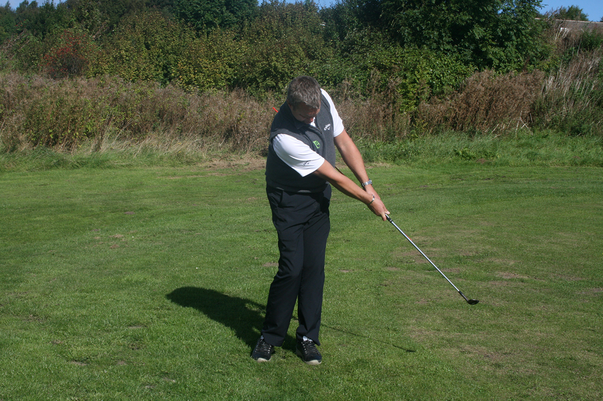 Through swing (using an alignment stick to keep arms and wrist firm)